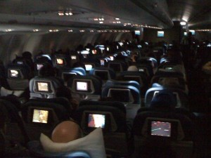 On a flight from Seattle to Tokyo. We're suppose to be sleeping